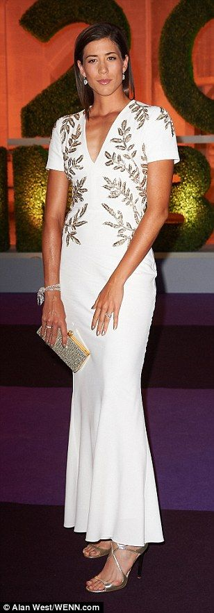 Garbine Muguruza turned heads in an elegant white dress as she attended the Wimbledon Champions Dinner at Guildhall, in London, on Sunday night after winning the women's singles title