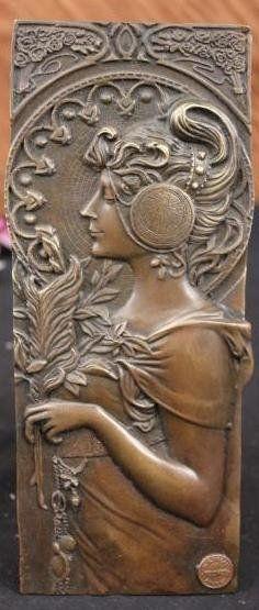 Mucha; Art Nouveau bronze bas relief plaque : Lot 110Av.  bronze plaque, Art Nouveau girl after Alphonse Mucha, signed; 9.5in. H. x 4in.  est. $200-$300