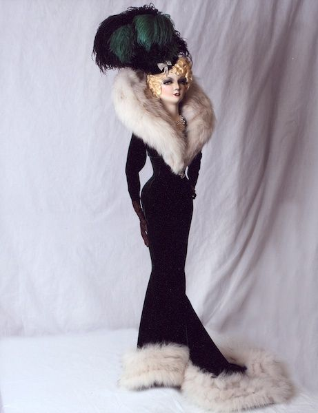 "Mae, by Dustin Coche'  An artist's rendition of Mae West in the 1937 film ""Every Day's a Holiday"". Her healthy hourglass figure is magnificent in her gown of jade velvet lavishly trimmed in silver fox fur.  39 INCHES (99.06 CM) TALL"