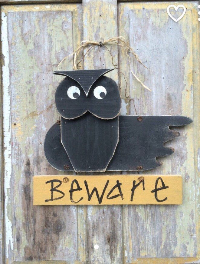 A personal favorite from my Etsy shop https://www.etsy.com/listing/470273917/owl-door-hanger-owl-decor-halloween
