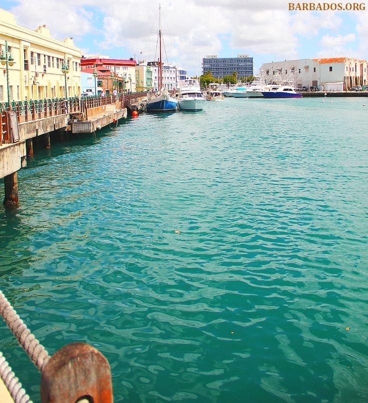 Stroll along the Bridgetown boardwalk, admiring the clear waters and historic buildings, as yachts, catamarans and fishing boats cruise by,