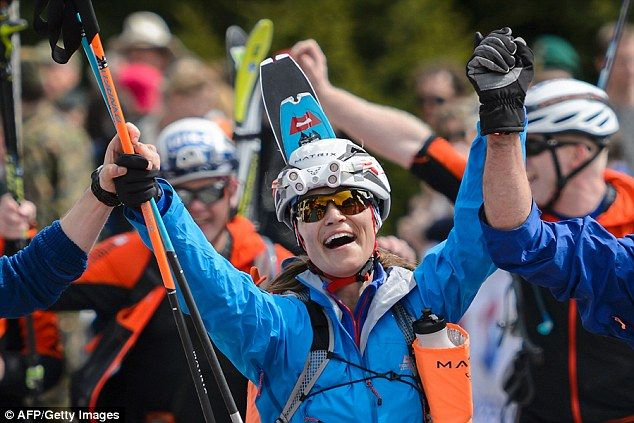 Victory! A jubilant Pippa celebrates as she crosses the finish line after completing a gruelling 53km ski race
