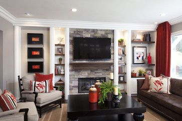 GREAT way to create functional space is with a built in that spans the fireplace symmetrically - traditional - family room - san diego - Robeson Design- Family room Entertainment center -