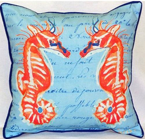 Each one of these bright coral seahorses beach house indoor-outdoor pillows is a miniature work of coastal art on a blue 18 x 18 durable, fade resistant fabric beach cottage pillow!