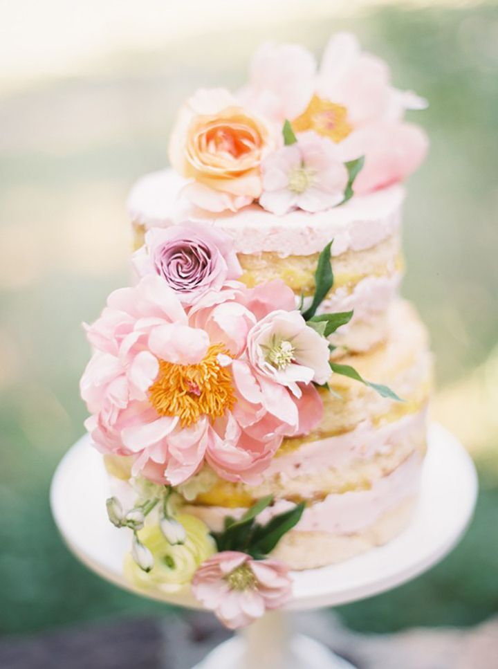 Prettiest little naked cake ever!  Peony, roses, hellebores and ranunculus in pale pink and peach ~ we ❤ this! moncheribridals.com