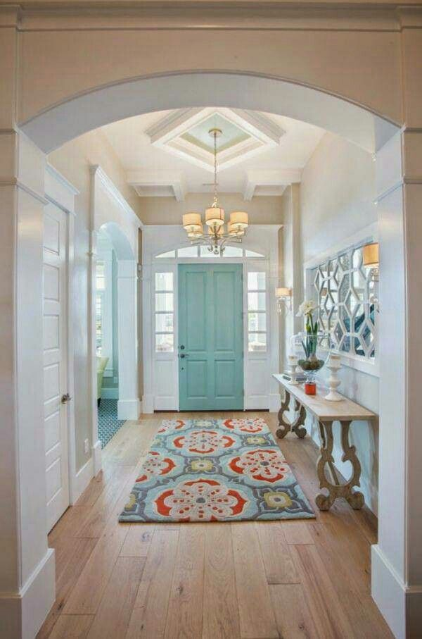Rug AK - notice the finish on the chandelier. Your foyer could include a bright or rustic teal art piece