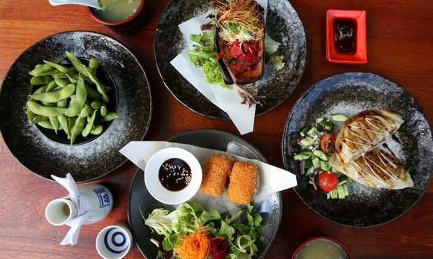Enjoy a Japanese meal with edamame, eggplant, gyoza, a sushi and sashimi platter, miso soup and main; includes dessert and sake or wine