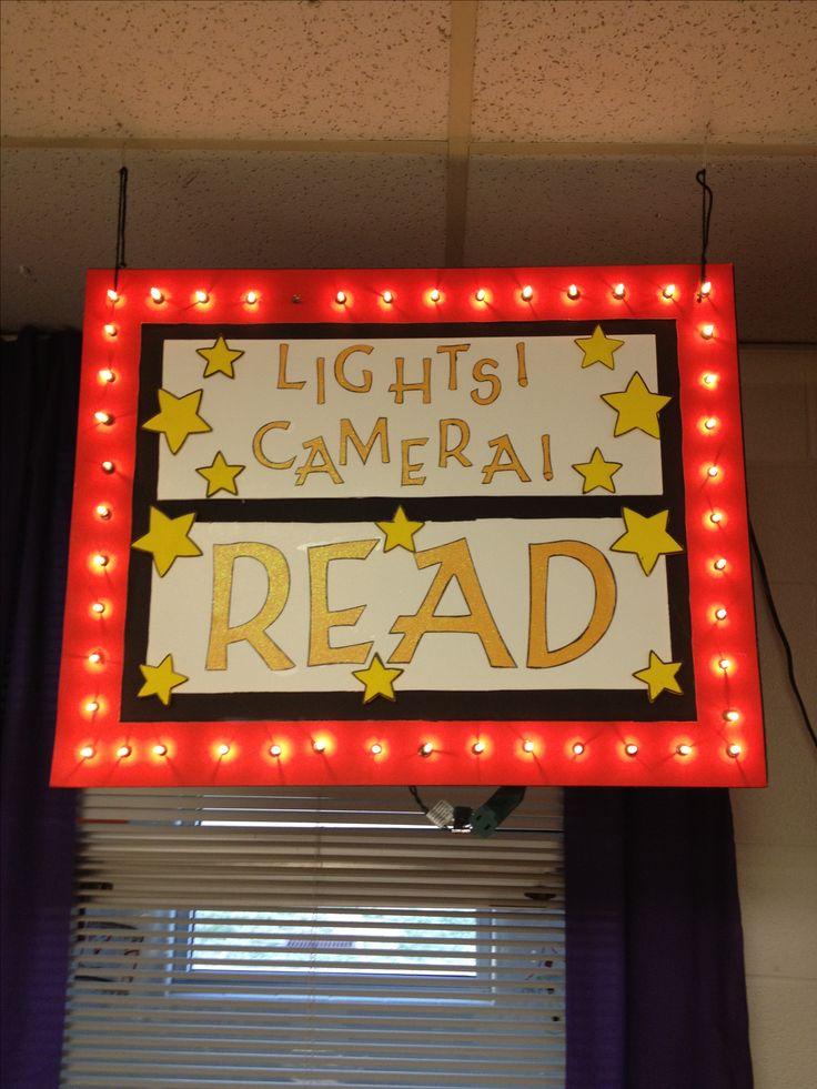 Foam board reading corner sign with lights.
