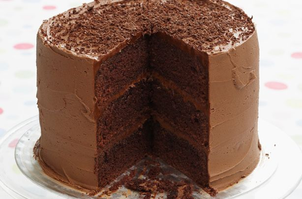 My eyes are bigger than my tummy but let the chocolate rain X three. Triple layer chocolate cake.