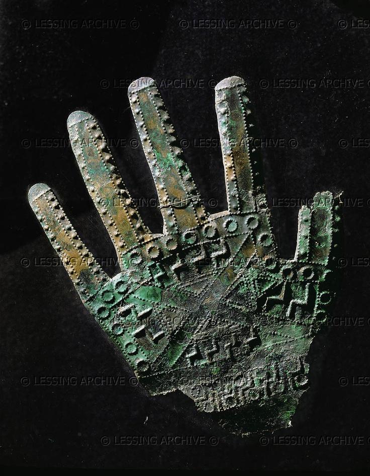 Hallstatt Culture Ornament, 10th-6th century BCE. Sheet-bronze hand with dotted line geometric ornaments, from Kroell/Schmied-Kogel, Kleinklein, Austria. Detail of 07-01-03/1 Length: 15.5 cm Landesmuseum Joanneum, Graz, Austria