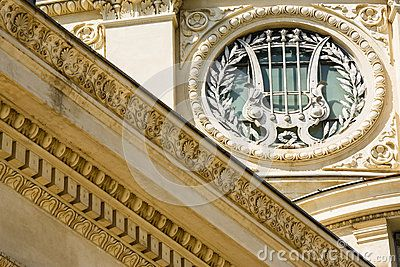 Architectural detail with harp and laurels on the frontispiece of the Atheneum edifice in Bucharest, Romania.