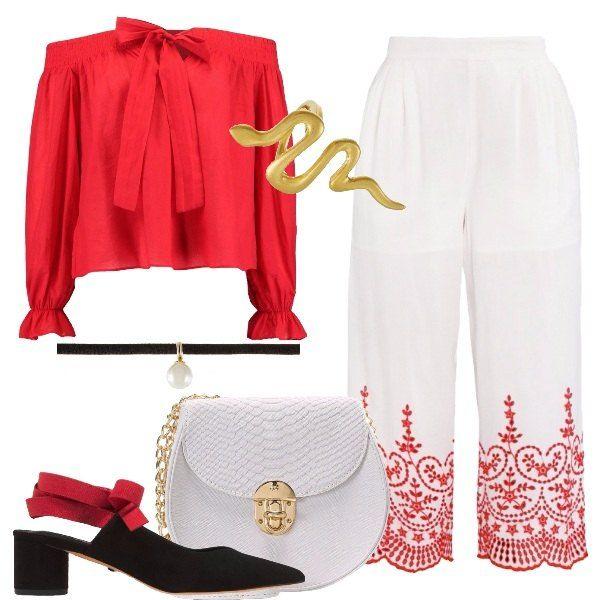La camicetta rossa con fiocco e spalle scoperte abbinata al pantalone culotte bianco con ricamo rosso. Spezza con eleganza la scarpa nera dal tacco medio con cinturino rosso a contrasto. Per completare la tracollina bianca, l'anello statement e il chocker con perla.