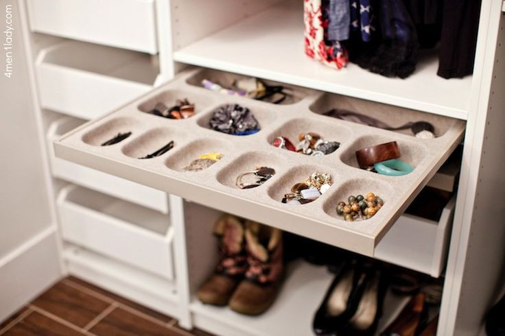 Gorgeous walk-in closet in bathroom features Ikea Pax Wardrobes and Ikea Pax Organizers over porcelain wood tiled floor.