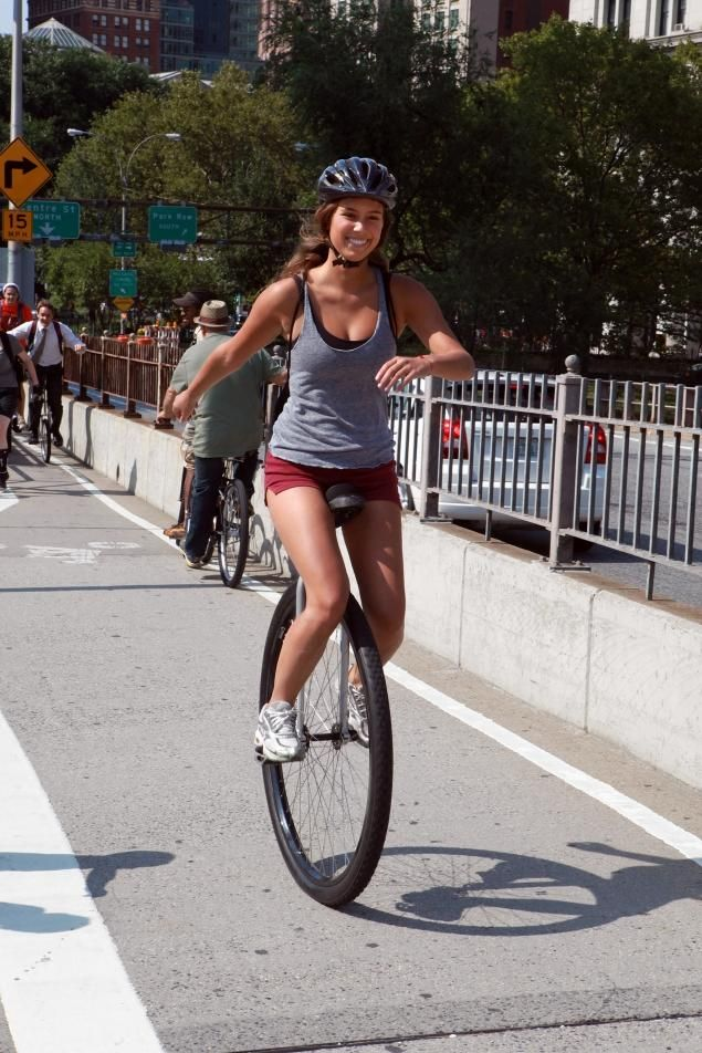 girl+on+unicycle | ... as they headed for Coney Island as part of the NYC Unicycle Festival