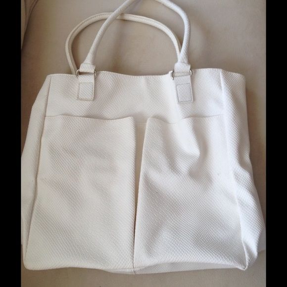 Neiman Marcus** Medium Tote Great cold weather commute & travel tote. Material: Nylon. Sorry, no Trades Bags Totes