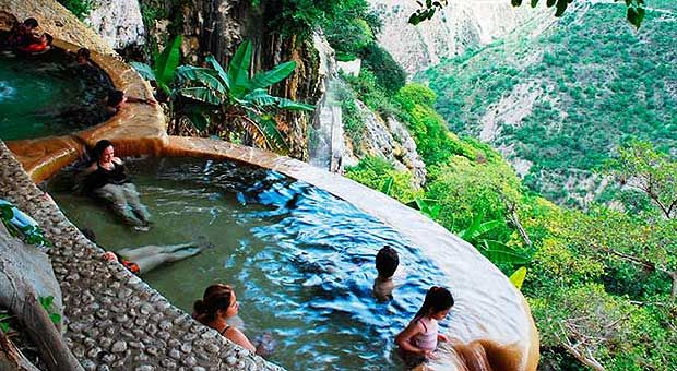 """If you're in need of a little R&R, have we got a hot tip for you. The Grutas de Tolantongo is a famed spa resort in the Mezquital Valley of Mexico, which is located in the State of Hidalgo, roughly three to four hours northeast of Mexico City. The resort """"is made up of three …"""
