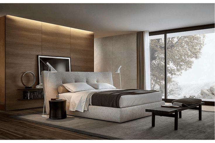 Poliform Rever Bed by Jean-Marie Massaud. Enveloping proportions for an elegant, yet austere bed. The ideal presence for large spaces with an imposing headboard that recalls the lapel of a jacket, an upturned collar. A style that re-appropriates the past with an eye on the present for an increasing individual aesthetics.