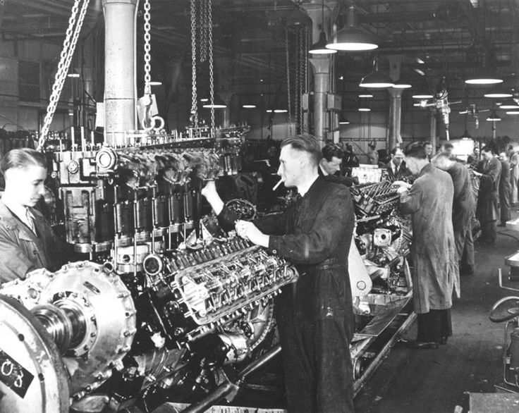 Rolls Royce Merlin engines in production in   Derby.  The Rolls-Royce Merlin is a British liquid-cooled, V-12, piston aero engine, of 27-litre (1,650 cu in) capacity. Rolls-Royce Limited designed and built the engine which was initially known as the PV-12: the PV-12 became known as the Merlin following the company convention of naming its piston aero engines after birds of prey.