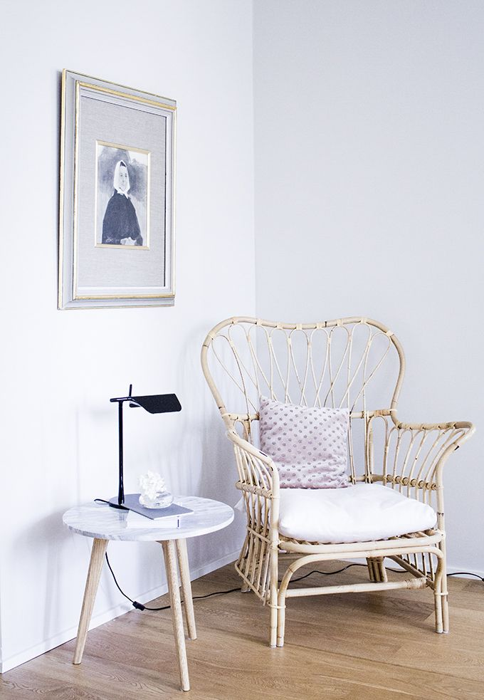 A reading nook. Josef Frank rattan chair, Flos Tab lamp, maybe side table via Coffee Table Diary