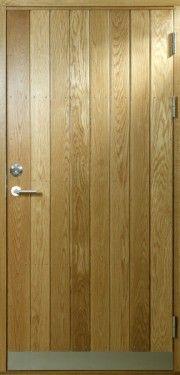 Långö - Ytterdörr med stående panel i massiv ek.