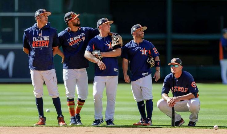 SIZING THINGS UP: Houston Astros players, from left, Carlos Correa, Marwin Gonzalez, Alex Bregman, Jose Altuve and manager A.J. Hinch look on during batting practice before a spring training game against the Chicago Cubs on March 30 in Houston.