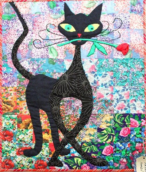 L'amour, patchwork art, black cat on watercolor quilt.  Russian patchwork exhibit at All Russia