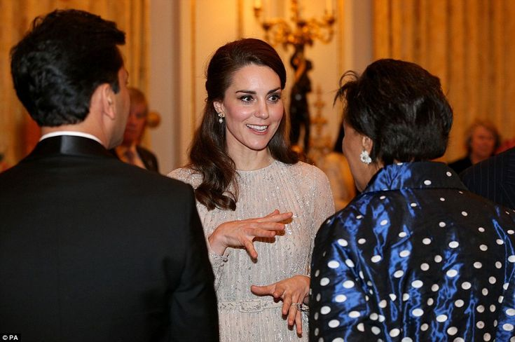 Kate kept her hair look simple for the event, keeping her loose curls in a half up-do...