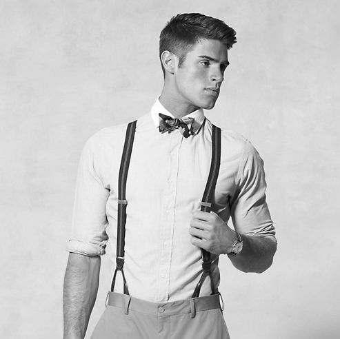 Suspenders and tie look very old fashioned, but adorable at the same time.