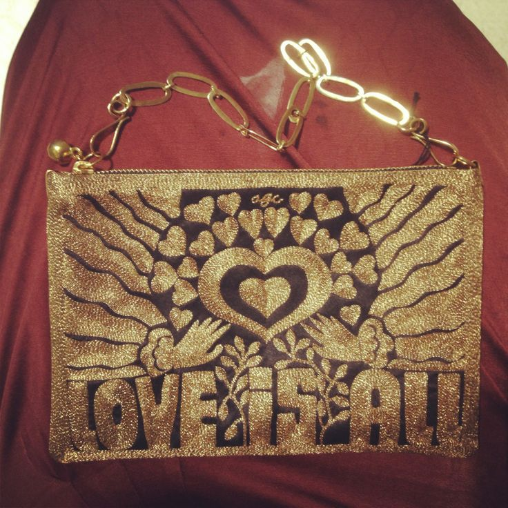 Day 4 - LOVE seeing this new arrival sitting on my lap! #MFW #MFW14 #loveisall  http://www.waitandsee.it/shop-the-store/accessories/bags/gold-love-is-all-pouch-ny