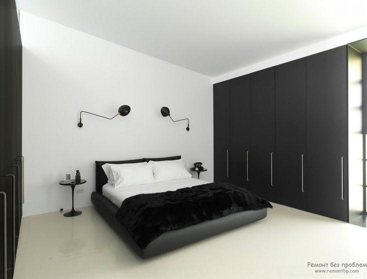 Черно-белый минималистский интерьер спальни со встроенными шкафами-купе