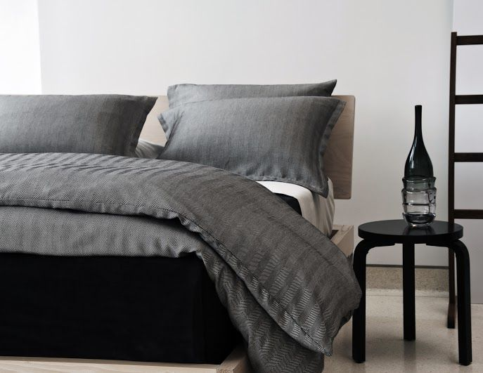 A handsome set of duvet and shams, woven in a luxurious 100% cotton sateen fabric. The set's subtle, micro-herringbone pattern almost reads as solid from afar, but is a lovely detail when viewed up close. The duvet hasmini flange detail with button closure.