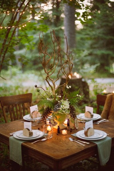 Elegant-Rustic-Centerpiece Mt. Rainier table centerpiece adding a couple of wildflowers and picture of the mountain