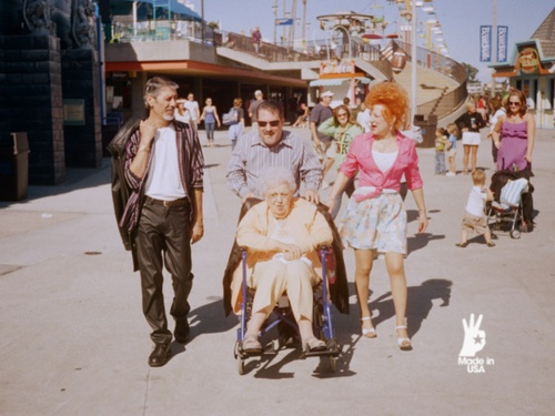 Family Outing / Santa Cruz Boardwalk, California.  A still from 'Made in USA', a documentary project created in association withwithAmerican Apparel.
