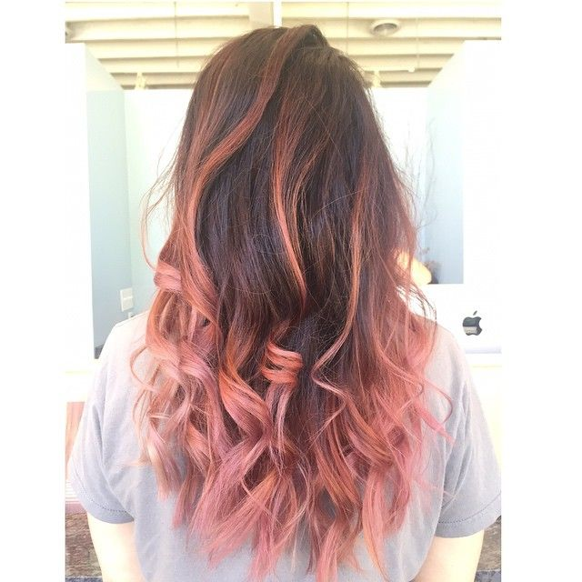 Pink and brown ombre achieved by aveda color. Love this unique pastel pink hair color.