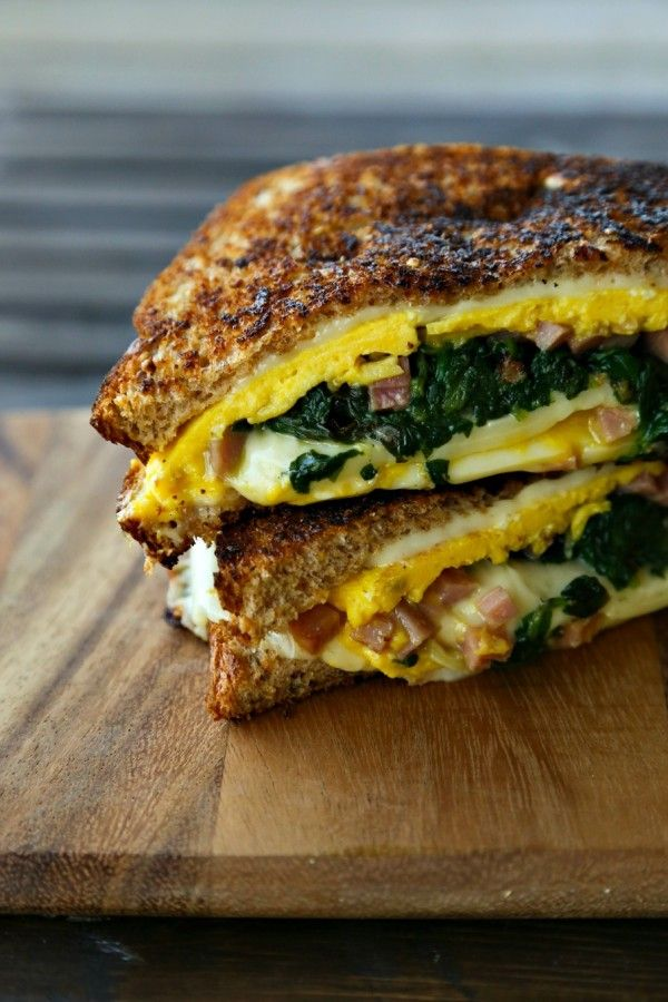 Grilled cheese night is sure to be a hit with this Spinach Omelet Grilled Cheese recipe from @foodiewithfam. Garlicky spinach, chopped ham and Deli American bring flavor to this sandwich! The Land O'Lakes Foundation will donate $1 to Feeding America® for every recipe pinned through April 30, 2015, for a guaranteed maximum of $350,000. (Pin any Land O'Lakes recipe or submit any recipe pin at LandOLakes.com/pinameal.)