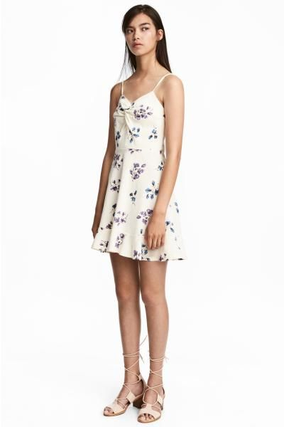Short dress in sturdy, patterned cotton jersey with narrow adjustable shoulder straps and a decorative knot detail at the bust. Concealed zip at the back, a