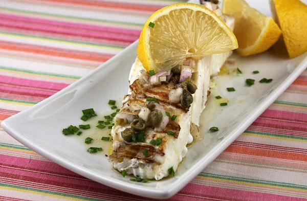 This recipe is for simply grilled fresh halibut fillets topped with an easy-to-make lemon caper vinaigrette.  Photograph and nutritional information included.