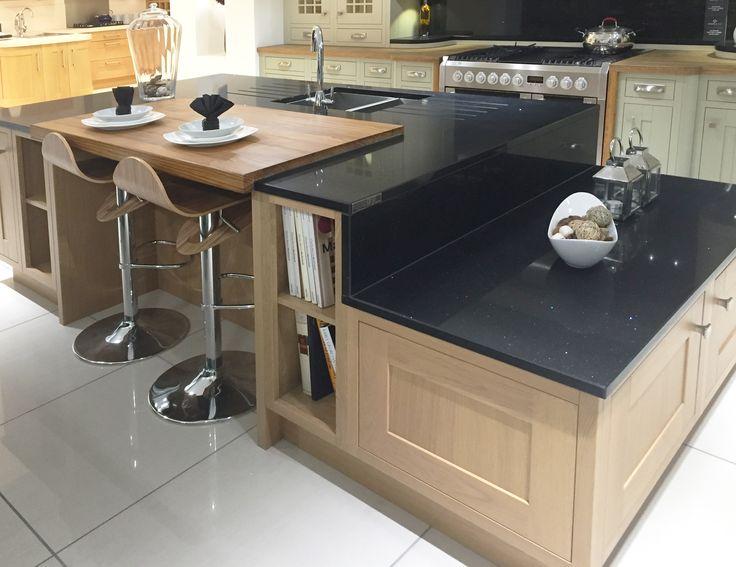 Contemporary kitchen island design in Lissa Oak, with split level granite worktops and breakfast bar area. www.sheratonkitchens.co.uk