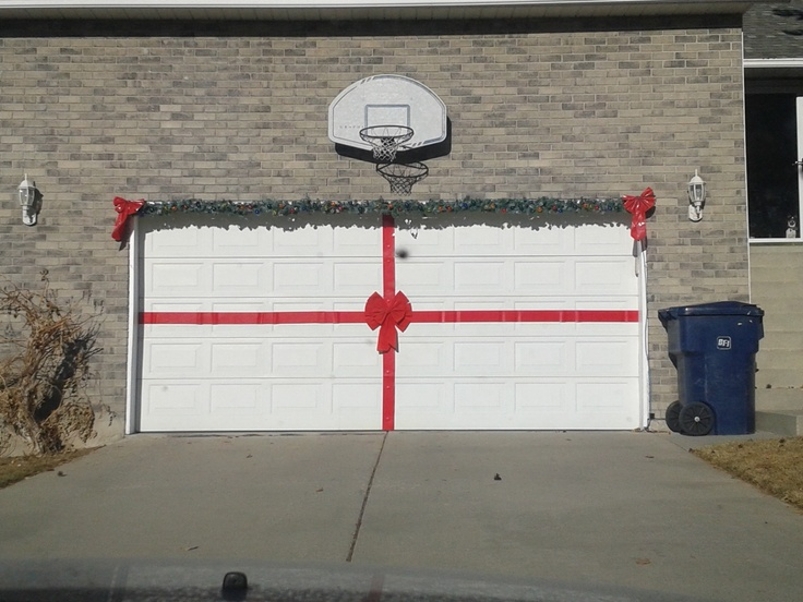 Make your garage door a giant present at christmas time for Christmas garage door mural