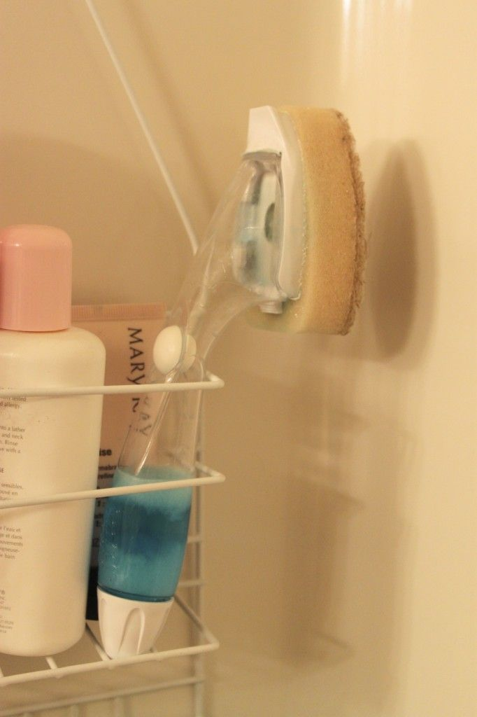 Dawn mixed with vinegar, stored in dish wiper, placed in shower. Wipe down walls during each shower!
