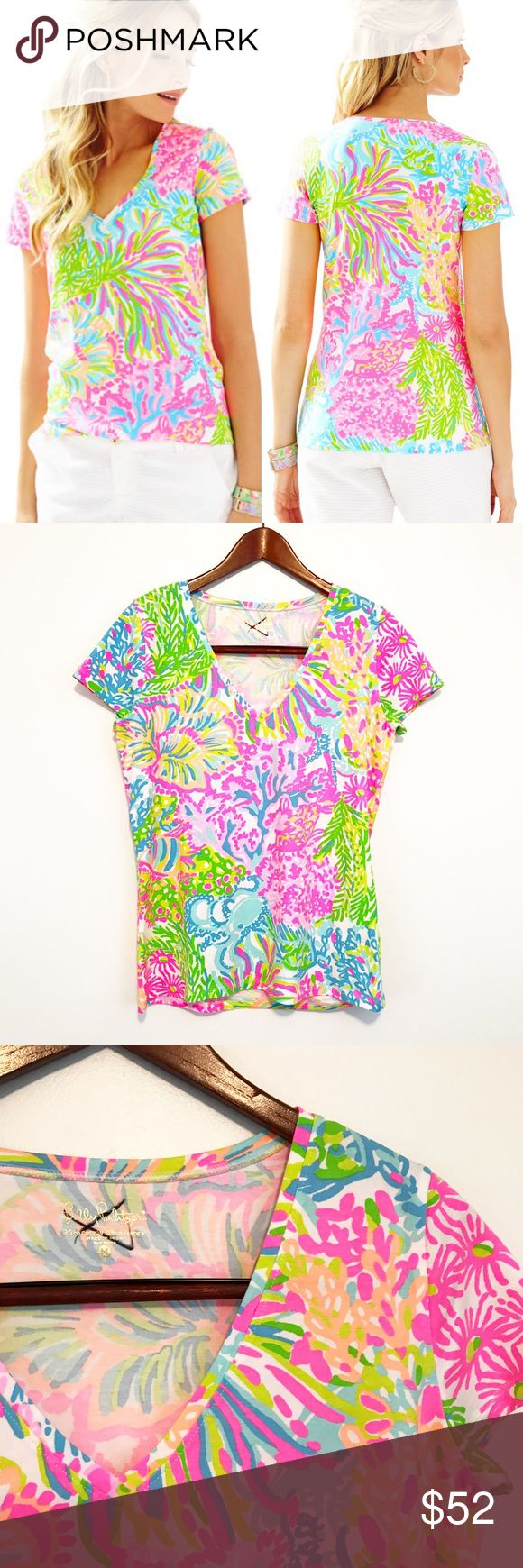 Lilly Pulitzer Lovers Coral Michelle Top Cotton Coral, octopus, and vibrant colors make this the perfect summer piece! Fun fact: annoyingly enough, the plural of octopus is actually octopuses instead of octopi. I know, it bothers me too. Anyways, the tag has been marked through on this one, but could possibly be removed if you're handier than I. (I have a reputation for ruining what I try to fix so I leave it the pros now. 🤷🏼♀️) Lilly Pulitzer Tops Tees - Short Sleeve