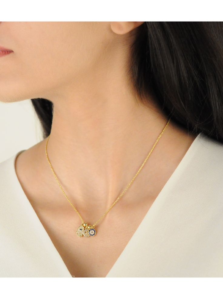 Lucky charm Necklace -  INR 1,999 - This 18K Gold finished charm necklace features 3 tiny charms which include the Evil Eye, Hamsa Hand and the Peace sign, all in cubic zirconia setting. The drop measures to about 19 cm.