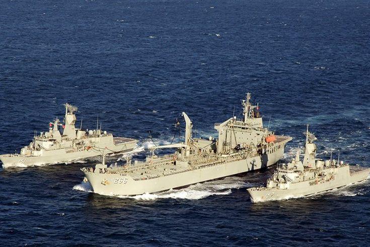 Anzac-class Frigates HMAS Arunta and HMAS Perth conduct a dual Replenishment at Sea with HMAS Sirius during Exercise Talisman Sabre 2015.
