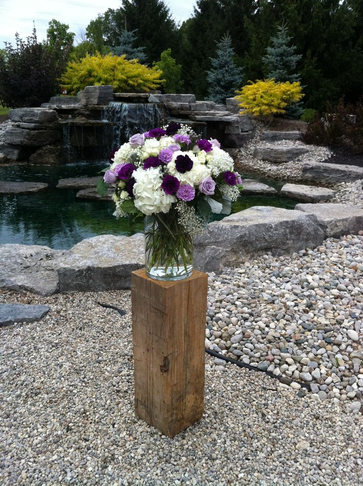 Wedding by the waterfall at the Beautiful Caradoc Sands. Flowers Designed by Olive Lane