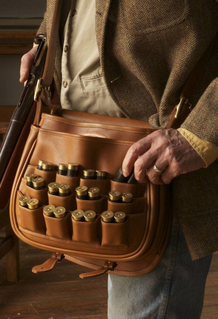 This doubles speed bag has two compartments for live and spent rounds. It has been made with bull hide and has a brass nameplate.
