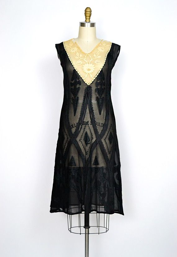 1920s flapper dress in sheer black silk chiffon with amazing art deco applique in diamond motif all throughout. Bodice has ecru colored floral lace and has been lovingly restored and reinforced. Tulle underlay the lace on top is whiter than the original lace.