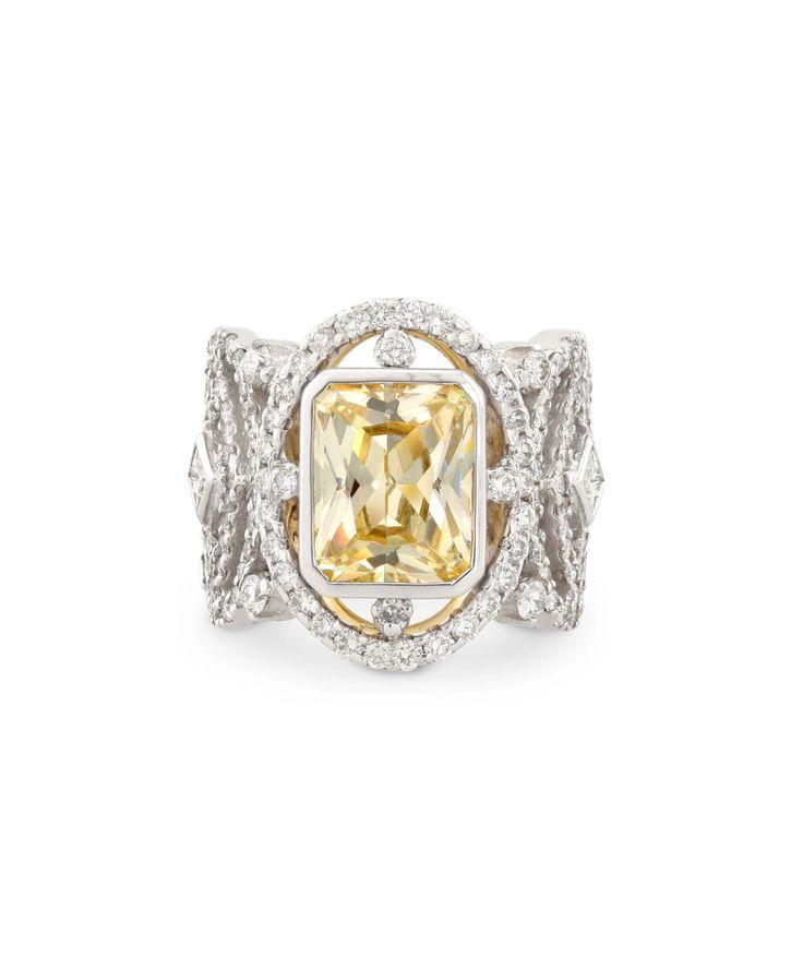 Love the warm tones of this subtle yellow sapphire set between white diamonds.