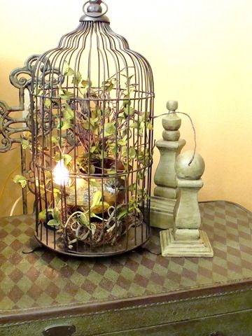 decked out birdcage on a pretty table