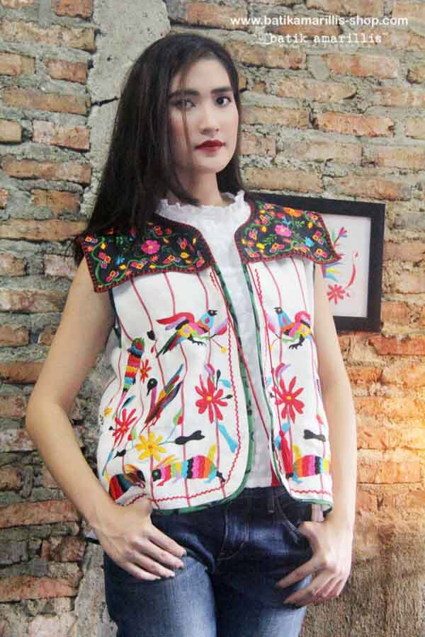 Batik Amarillis made in Indonesia proudly presents: Super cool Batik Amarillis's Pepito vest This awesome piece of clothing which features hand stiching and hand knitting lace  plus bold  & beautiful Mexican folkore embroidery inspired is MUST HAVE item to your wardrobe :)