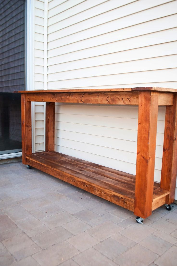 Outdoor buffet -would drill a hole for an umbrella. A deeper piece would be better. Bottom shelf for place settings and cups.